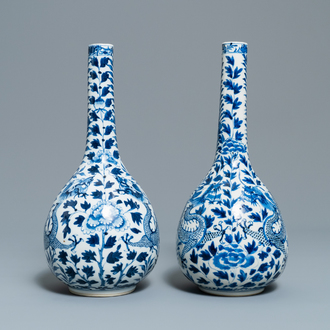 A pair of Chinese blue and white bottle vases with dragons, 19th C.