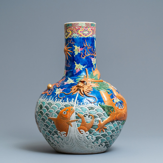 A large Chinese famille rose relief-decorated dragon and carps tianqiu ping vase, Kangxi mark, 19th C.