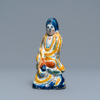 A polychrome Dutch Delft chinoiserie figure of the Chinese goddess Guanyin, 1st quarter 18th C.
