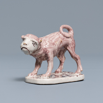 A manganese Lille faience model of a monkey, late 18th C.