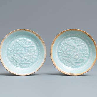 A pair of Chinese qingbai moulded saucer dishes, Song
