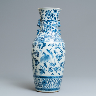 A Chinese blue and white vase with birds among flowers, 19th C.