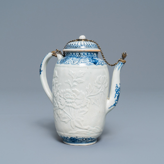 A large Japanese blue and white moulded Arita teapot with gilt silver mounts, Edo, 17th C.