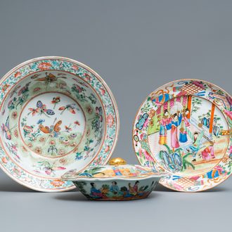 A Chinese Canton famille rose tureen and cover, a plate and a famille rose 'butterfly' bowl, 19th C.