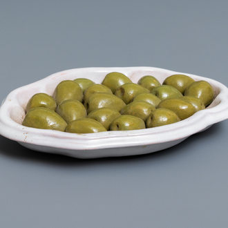 A French faience trompe-l'oeil dish with olives, Moustiers, 18th C.