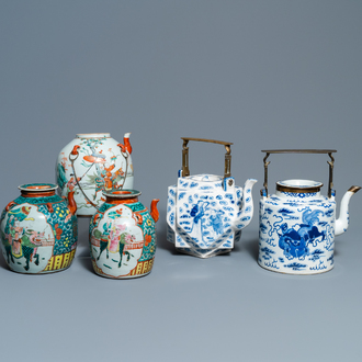 Two large Chinese blue and white and three famille rose teapots, 19/20th C.