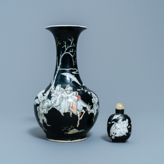 A Chinese black-ground grisaille and iron red vase and a snuff bottle, 18th C.
