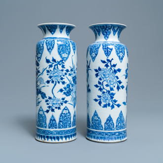 A pair of Chinese blue and white vases with floral designs, Kangxi