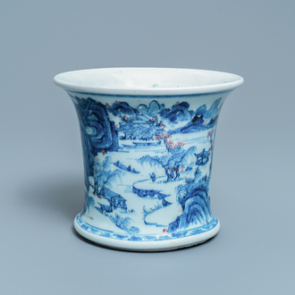 A fine Chinese blue, white and copper red 'Master of the Rocks' brush pot, Kangxi