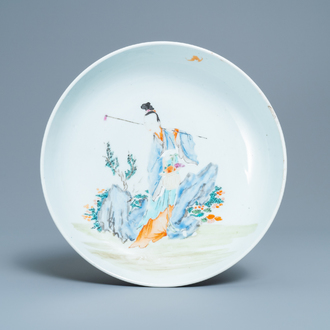 A Chinese famille rose dish with a lady in a landscape, Yongzheng
