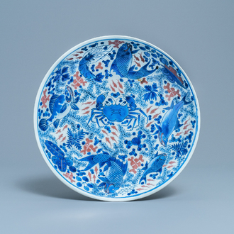 A Chinese blue, white and copper red 'crab and fish' dish, Kangxi