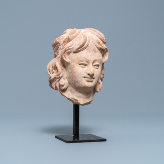 A terra-cotta head of a man in Hellenistic style, India, Gandhara, 2nd/4th C.