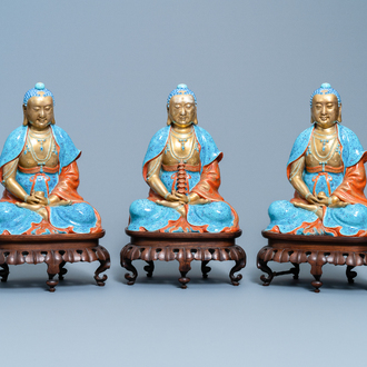 Three Chinese enamelled and gilt figures of Bodhisattva, Qianlong/Jiaqing