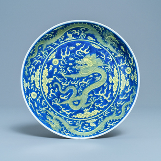 A Chinese underglaze blue and yellow-glazed 'dragon' dish, Qianlong mark and of the period