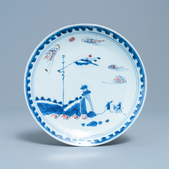 A Chinese blue, white and copper red plate, Ming