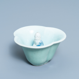 A Chinese blue, white and celadon-glazed 'Lu Hong Jian' puzzle or trick cup, Qianlong