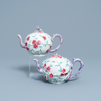 A pair of Chinese famille rose relief-decorated teapots with floral design, Yongzheng