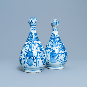 A pair of Chinese blue and white 'garlic head' bottle vases, Wanli