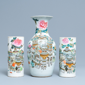 Two Chinese qianjiang cai hat stands and a vase with antiquities, 19/20th C.