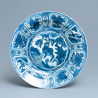 A large Chinese blue and white kraak porcelain dish with a mythical beast, Wanli