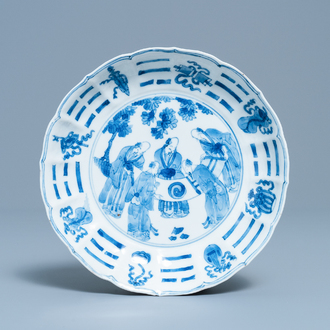A Chinese blue and white plate with scholars admiring a scroll, Chenghua mark, Kangxi