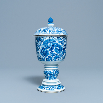 A Chinese blue and white beaker and cover with floral design, Kangxi