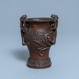 A Chinese dragon-handled bronze vase, Ming