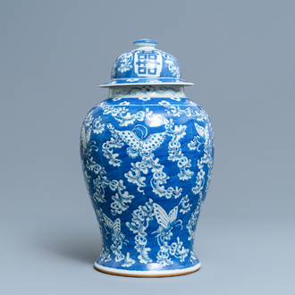 A Chinese blue and white 'butterfly' vase and cover, 19th C.