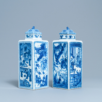 A pair of Chinese blue and white square vases and covers, Kangxi
