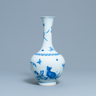 A rare Chinese blue and white bottle vase with a cat and a butterfly, Transitional period