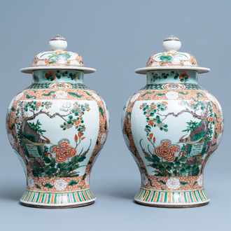 A pair of Chinese famille verte vases and covers, Kangxi mark, 19th C.