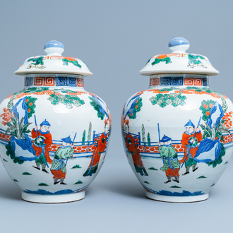 A pair of Chinese wucai vases and covers, Kangxi mark, 19th C.