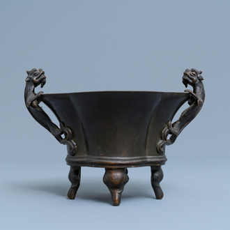 A Chinese chilong-handled bronze censer, Xuande mark, 18th C.