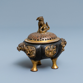 A Chinese lacquered and parcel-gilt bronze tripod censer and cover, Ming