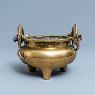 A Chinese bronze chilong-handled tripod censer, seal mark, 17/18th C.