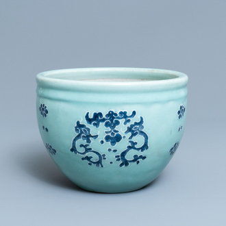 A Chinese blue and white celadon-ground jardinière, Qianlong