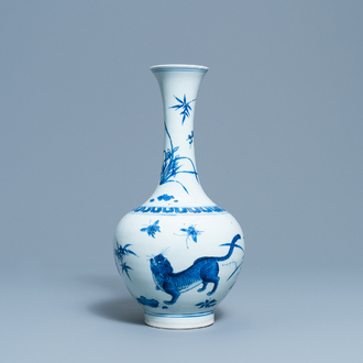 A rare Chinese blue and white bottle vase with a tiger and two butterflies, Transitional period