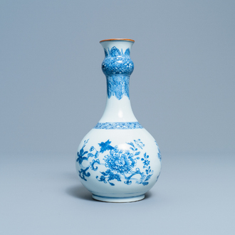 A Chinese blue and white bottle vase with floral design, Yongzheng/Qianlong