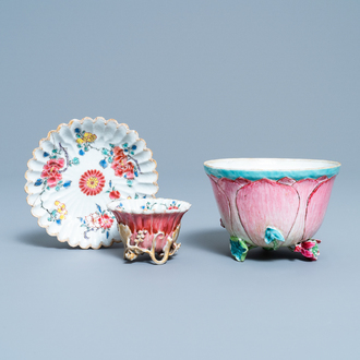 A Chinese famille rose cup and saucer and a 'magnolia' cup, Yongzheng