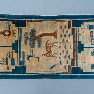 A rectangular Chinese hand-knotted wool carpet with a crane and a deer, 19/20th C.
