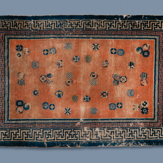 A rectangular Chinese hand-knotted wool carpet with brocade balls, 19th C.