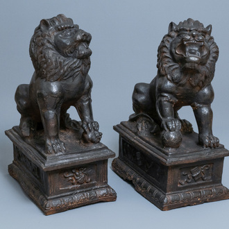 A pair of large Chinese cast iron models of lions, Ming mark and of the period