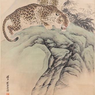 Liu Kuiling (China, 1885-1967), ink and colour on paper: 'Two leopards in a mountain landscape'