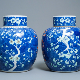 A pair of Chinese polychrome 'prunus on cracked ice' jars and covers, 19th C.