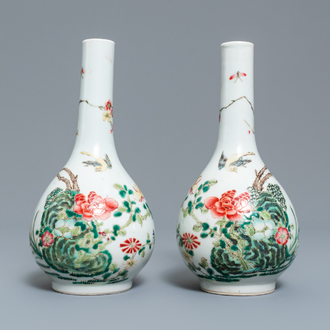 A pair of Chinese famille rose bottle vases, 19th C.