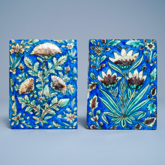 Two polychrome floral relief-moulded tiles, Qajar, Iran, 19th C.