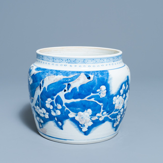 A Chinese blue, white and copper red 'prunus flowers' bowl, Kangxi