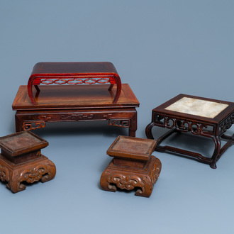 Five Chinese wooden stands, 19/20th C.