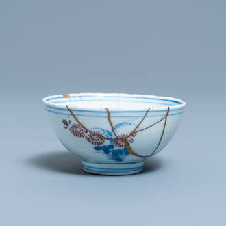A Chinese blue, white and copper red bowl with kintsugi repair, Chenghua mark, Kangxi