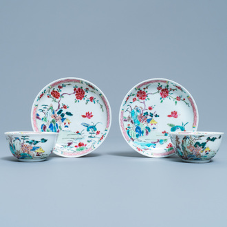 A pair of Chinese famille rose 'mountainous landscape' cups and saucers, Yongzheng